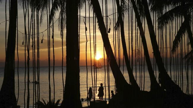 Last sunset: Tourists watch the setting of the sun on Boracay's last day before the shutdown. Picture: AP/Aaron Favila
