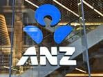 An ANZ sign adorns a branch of the bank in Sydney on May 3, 2016. ANZ Bank on May 3 posted an interim net profit slump of 22 percent on the back of impairment and restructuring charges that the lender said would reposition it for the future. / AFP PHOTO / WILLIAM WEST