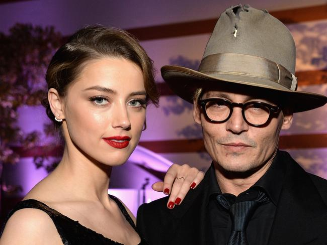 Family footsteps ... Johnny Depp and fiance Amber Heard at a LA gala earlier this year. Picture: Getty
