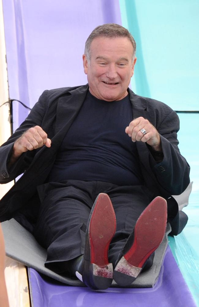 Robin Williams attends the premiere of Happy Feet Two in 2011.
