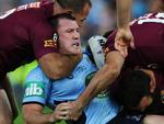 Paul Gallen gets strong-armed by the Maroons. Picture Gregg Porteous