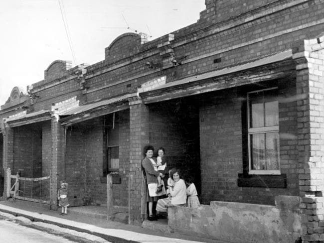 July 1964: These are the kinds of houses that the large housing commission flats in Carlton replaced. Picture: Herald Sun Image Library