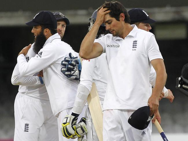 England's Captain Alastair Cook (R) reacts as the match is drawn on the fifth and final day of the first cricket Test match between England and Sri Lanka at Lord's.