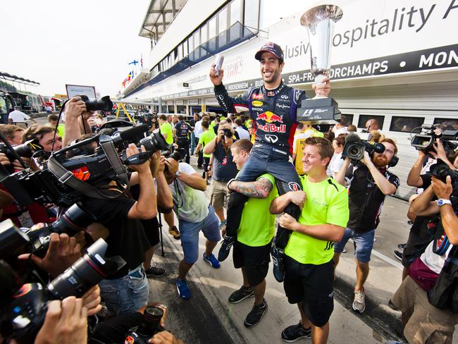Daniel Ricciardo celebrates his victory at the Hungarian Grand Prix with Red Bull.