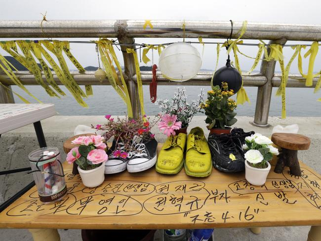 Disaster...footwear of missing passengers of the sunken ferry Sewol are displayed by their relatives as an act of remembrance at a port in Jindo, South Korea. Picture: AP