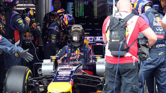 A frustrated Vettel climbs out of his car after retiring from third place at Monaco.