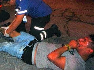Paramedics attend an injured man at the Blue Parrot nightclub in Playa del Carmen, Quintana Ro state, Mexico where 5 people were killed, three of them foreigners, during a music festival on January 16, 2017. A shooting erupted at an electronic music festival in the Mexican resort of Playa del Carmen early Monday, leaving at least five people dead and sparking a stampede, the mayor said. Fifteen people were injured, some in the stampede, after at least one shooter opened fire before dawn at the Blue Parrot nightclub during the BPM festival. / AFP PHOTO / VICTOR VARGAS / MAXIMUM QUALITY AVAILABLE