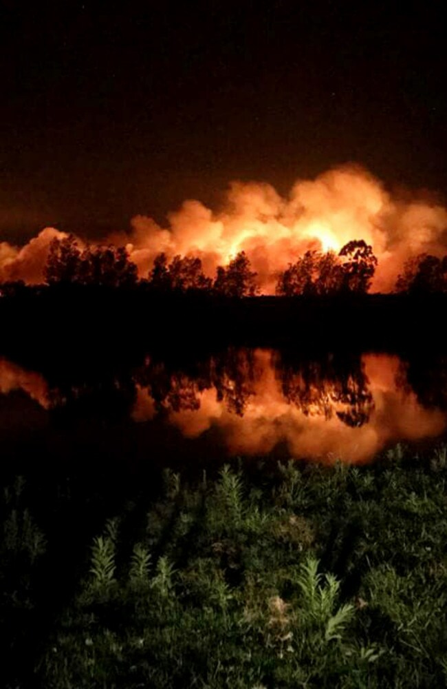 A fire is seen burning at Crescent Head, near Port Macquarie on Thursday night. Picture: Mikaela Priest.