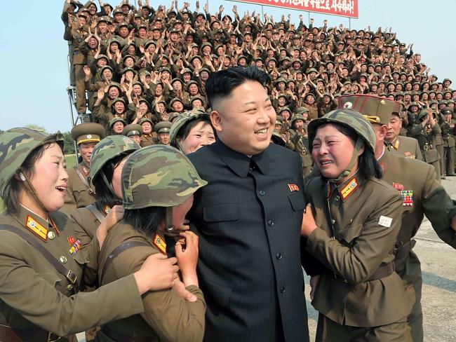 Being praised ... North Korean leader Kim Jong-un smiling with female soldiers after he inspected the multiple-rocket launching drill of women's sub-units under Korean People's Army (KPA) Unit 851 at undisclosed place in North Korea. Picture: KCNA