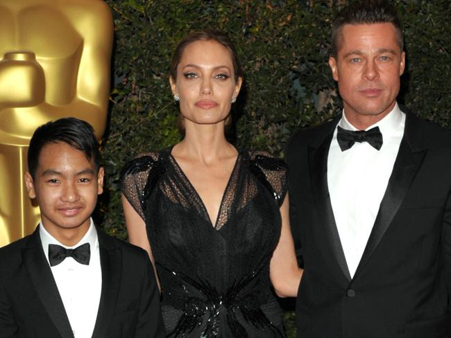 Maddox Jolie-Pitt, from left, Angelina Jolie and Brad Pitt in 2013. Picture: AP
