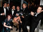 Actors Andy Samberg, Nick Offerman, Megan Mullally (crouching), Adam Scott, Amy Poehler (being held upside-down), Bill Hader, Bill Murray, and Paul Rudd attend the 2014 Vanity Fair Oscar Party. Picture: WireImage