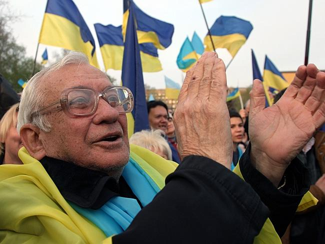 Something to cheer ... A pro-Ukrainian supporter applauds during a mass rally in the eastern Ukrainian city of Donetsk.
