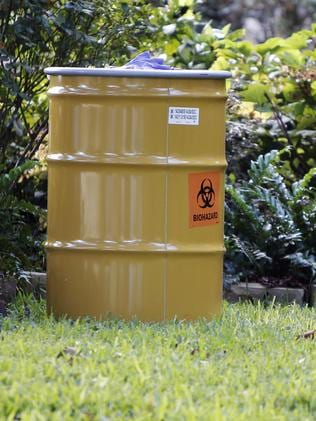 A barrel labelled biohazard on the lawn of the property. Pic: AP/Brandon Wade.