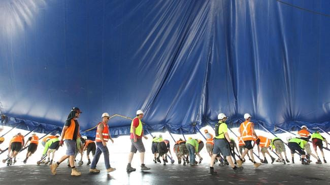 Workers setting up the big top tent for an upcoming Cirque de Soleil production in Adelaide.
