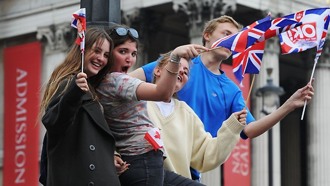 Revelers cheer Prince William and Kate. The wedding brought people from all over the world to London. Picture: Getty Images