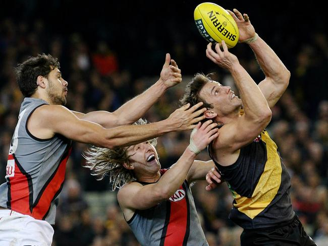 Ivan Maric outmarks Paddy Ryder and Dyson Heppell. Picture: Colleen Petch