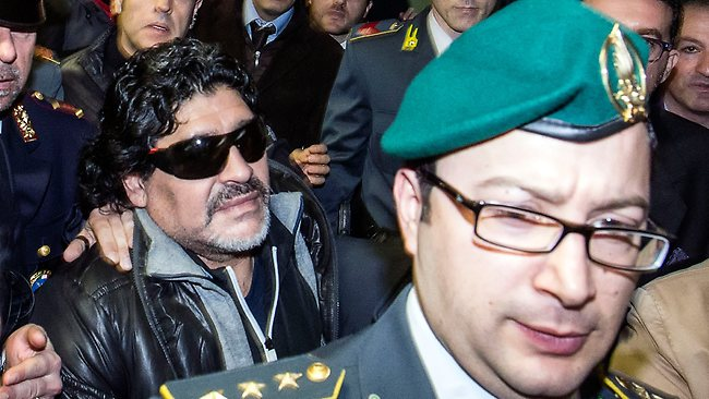 Diego Armando Maradona arrives at the Rome Fiumicino airport Monday, Feb. 25, 2013. Maradona is heading to Naples to attend a TV show and a press conference. (AP Photo/Angelo Carconi)