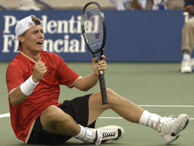 Lleyton Hewitt celebrates defeating Pete Sampras in the US Open final.