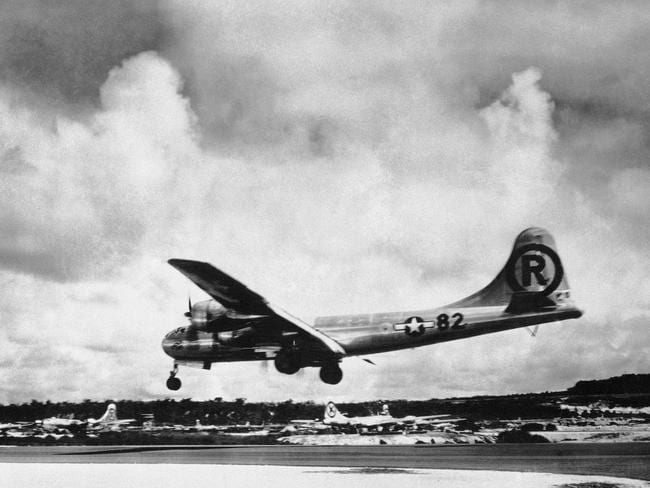 "The ""Enola Gay"" Boeing B-29 Superfortress lands at Tinian, Northern Mariana Islands after the U.S. atomic bombing mission against Hiroshima. Pic: AP/Max Desfor."