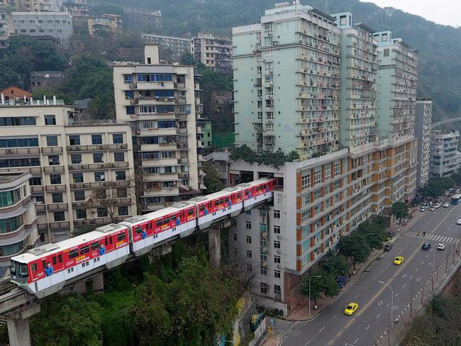 The train passes into the opening eight storeys up. Picture: VCG/Getty Images