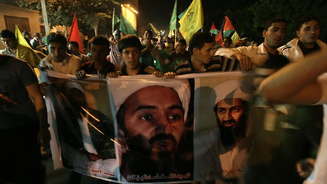 Palestinians hold pictures depicting Osama bin Laden, as they march to celebrate the signing of a reconciliation deal between bitter rivals Hamas and Fatah. Picture: AFP