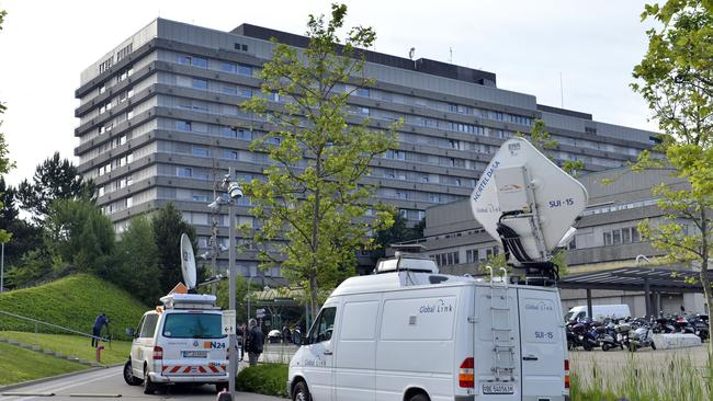 Television vans are parked in front of the University Hospital of the Canton of Vaud in Lausanne.