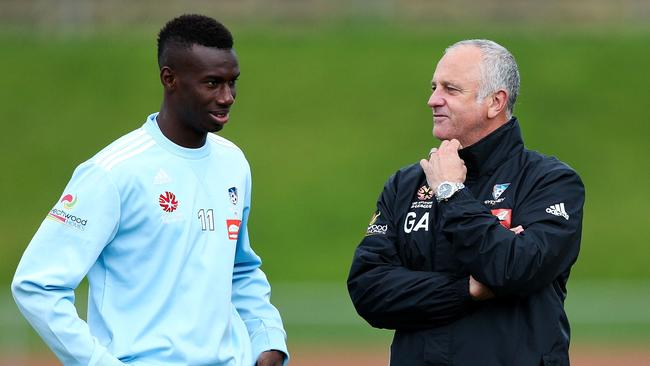 Coach Graham Arnold speaks to Bernie Ibini-Isei.