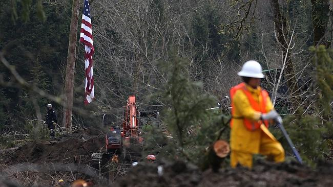 Search ... first responders continue to search the debris for missing people. Picture: Getty Images/AFP