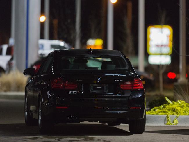 A vehicle sits at a car dealership after a random shooting in Kalamazoo. Picture: Bryan Bennett/Kalamazoo Gazette-MLive Media Group via AP