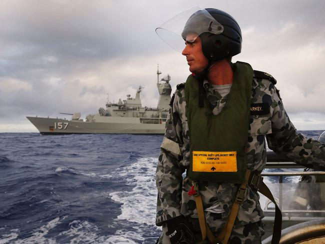 HMAS Perth searches for missing Malaysia Airlines flight MH370 in the southern Indian Ocean. Picture: Australian Defence/AFP