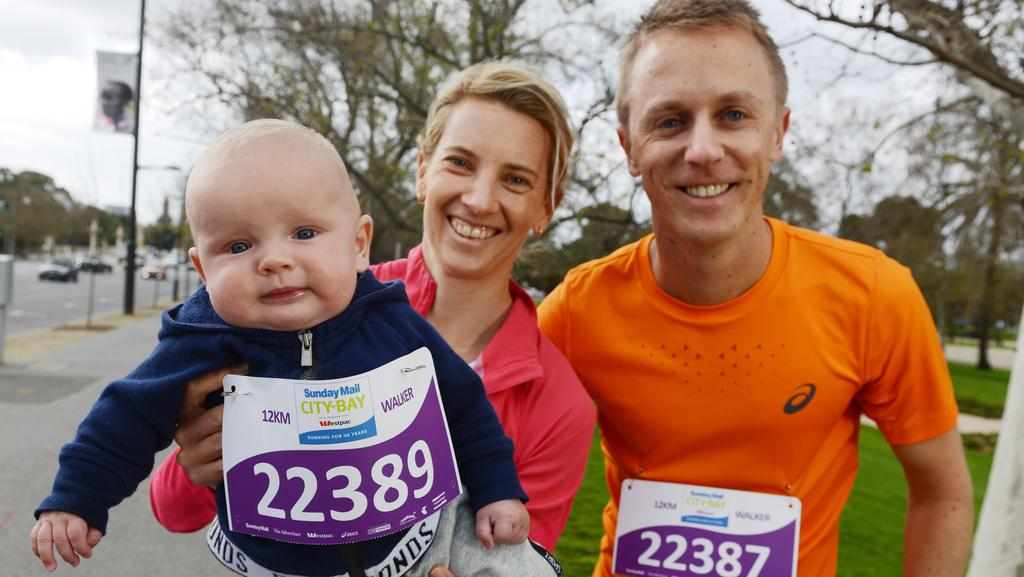 Racewalkers Jared and Claire Tallent get ready for the Sunday Mail City-Bay Fun Run with their baby boy, Harvey. Picture: Brenton Edwards/AAP
