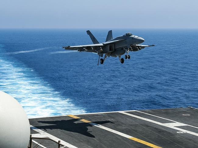 "An F/A-18E Super Hornet, attached to the ""Golden Warriors"" of Strike Fighter Squadron (VFA) 87, as it prepares to land aboard the aircraft carrier USS George H.W. Bush (CVN 77) in the Mediterranean Sea. Picture: AFP/USN"