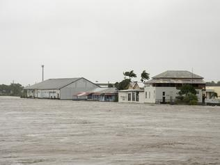 Pioneer River flooding in Mackay after tropical cyclone Debbie hit the north Queensland region, Wednesday, March 29, 2017. There are fears hundreds of homes and businesses have been damaged by ex-tropical cyclone Debbie after it hit north Queensland with ferocious winds and driving rain. (AAP Image/Daryl Wright) NO ARCHIVING