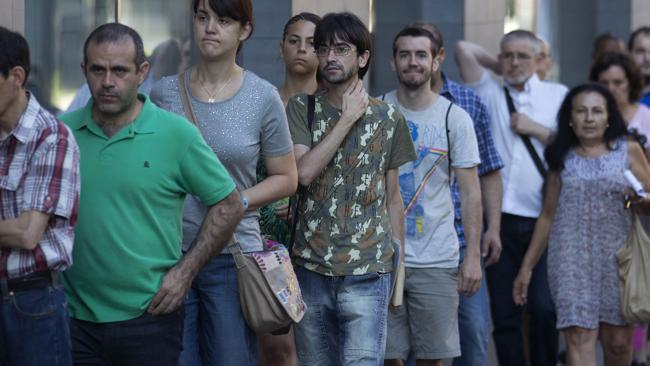 Spaniards queue at an unemployment registry office in Madrid. Mission Australia chief executive Toby Hall says youth unemployment on the fringes of Australia's capital cities has grown to Spanish crisis levels.