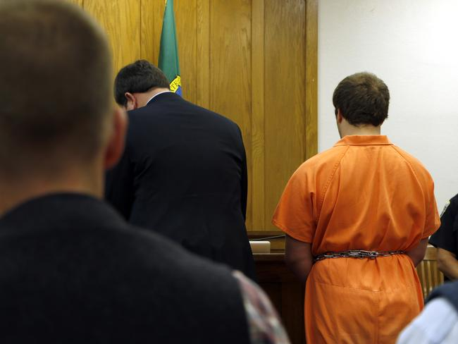Behind bars ... Gabriel Gaeta, right, stands next to his lawyer at a hearing in Kitsap County Superior Court, on Monday, Aug. 11, 2014, in Port Orchard, Washington. Picture: AP