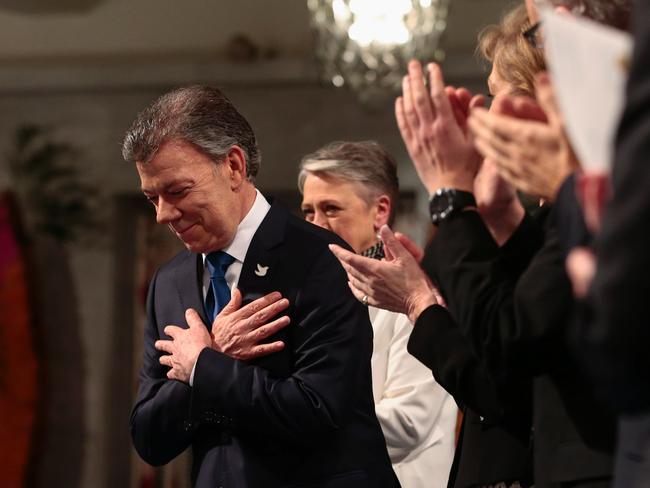 Nobel Peace Prize laureate Colombian President Juan Manuel Santos is applauded during the Nobel Peace Prize award ceremony. Picture: AFP.