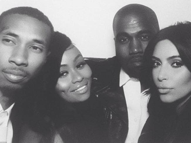 Kim Kardashian and Kanye West pose with Black Chyna and T-Raww at a photo booth at their wedding reception. Instagram