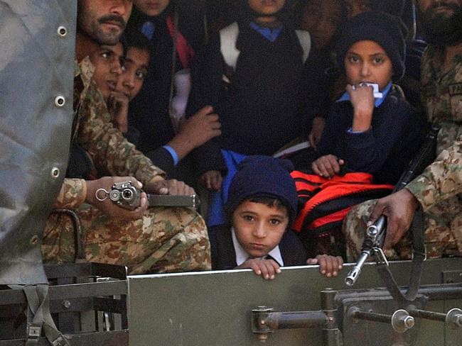 Innocents ... Pakistani soldiers transport rescued schoolchildren after the Taliban attack on a school in Peshawar. Picture: AFP