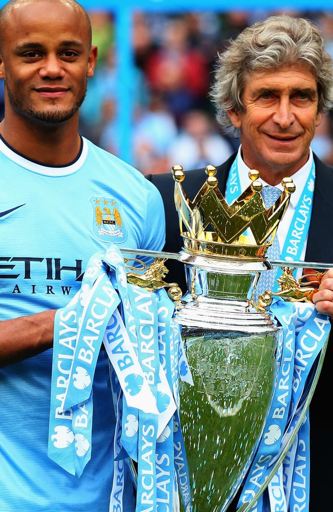 Vincent Kompany poses with manager Manuel Pellegrini and the Barclays Premier League trophy.