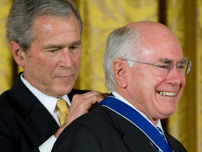 Besties ... Former US President George W Bush presents the Presidential Medal of Freedom to Australia's former Prime Minister John Howard in 2009. Picture: Supplied