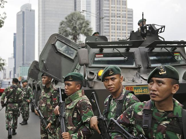 Indonesian soldiers stand guard ... near the site where an explosion went off in Jakarta