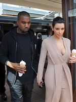 <p>Kim Kardashian and Kanye West have the look of love as they cool off with an ice-cream in Cannes. Picture: Snappermedia</p>  <br />