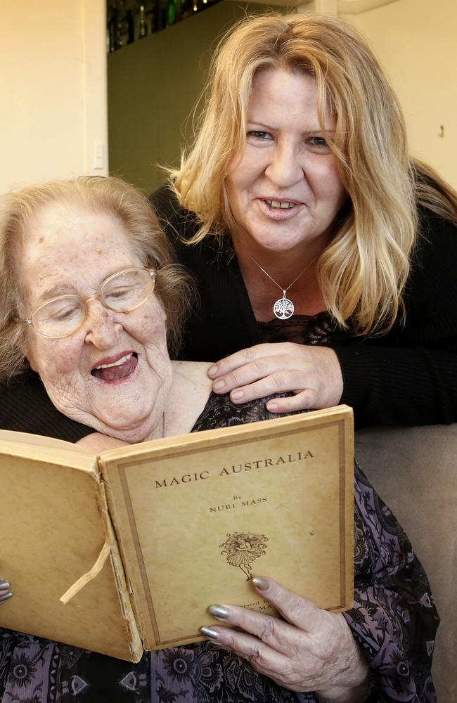 Betty and her daughter Liz Crooke look through the recovered children's book. Picture: David Caird.