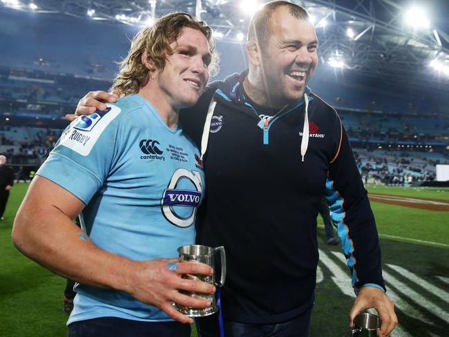 Captain Michael Hooper and Michael Cheika are all smiles after the last-ditch victory over the Crusaders.