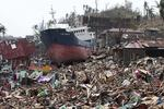 A ship lies on top of damaged homes after it was washed ashore in Tacloban city, Leyte province, central Philippines. (Aaron Favila)