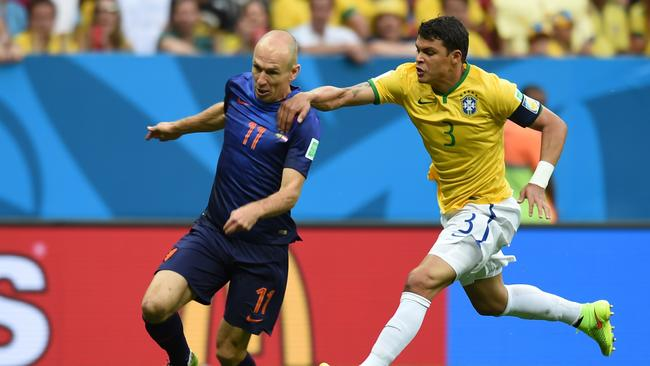 Netherlands' forward Arjen Robben (L) is fouled by Brazil's defender and captain Thiago Silva.