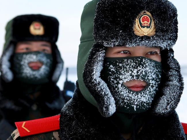Chinese paramilitary police border guards train in the snow at Mohe County in China's northeast Heilongjiang province, on the border with Russia.