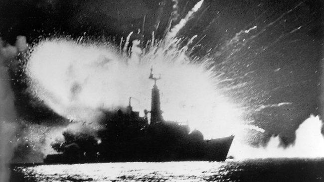 British Royal Navy frigate HMS Antelope explodes in the bay of San Carlos off East Falkland during the Falklands War, 1982. Photo by Martin Cleaver/Pool/Getty Images