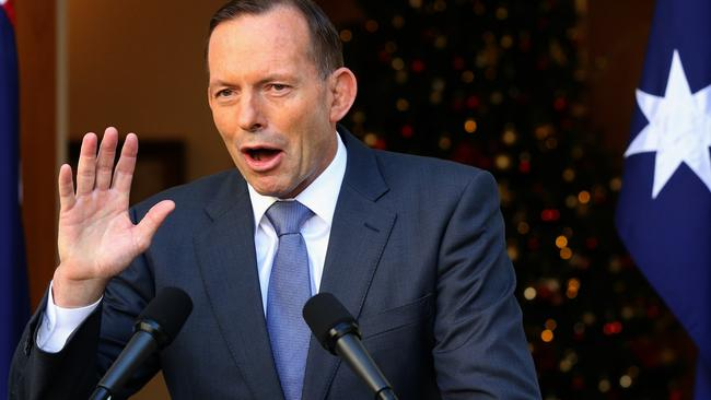 "Boats and budget ... PM Tony Abbott reflects on the ""year of delivery"". Picture: Ray Strange/News Corp."