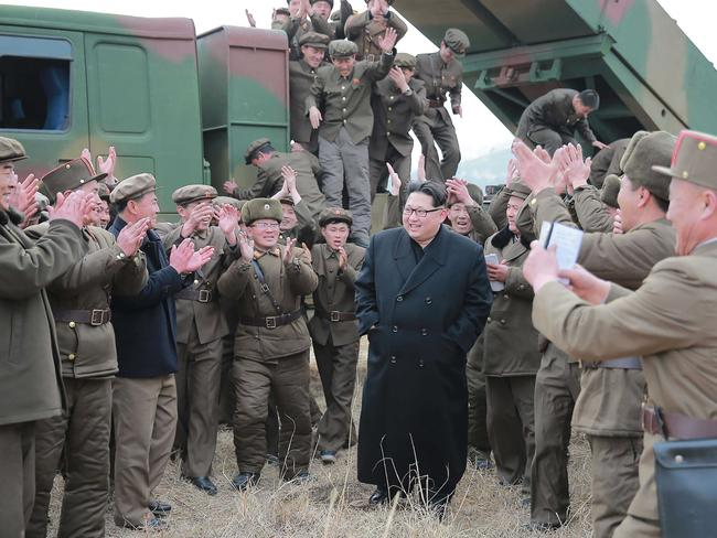 North Korean leader ... Kim Jong-un inspecting a test-fire of the new-type large-caliber multiple launch rocket system at an undisclosed location. Picture: AFP.